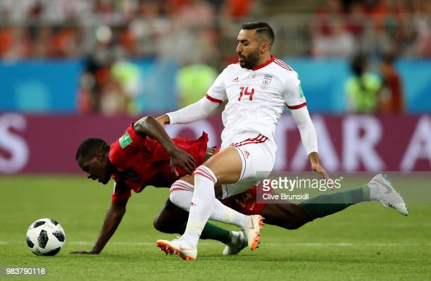Saman Ghoddos of Iran tackles William of Portugal during the 2018 FIFA World Cup Russia group B match between Iran and Portugal at Mordovia Arena on...