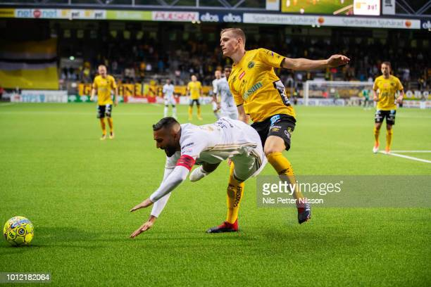 Saman Ghoddos of Ostersunds FK is tackled by Joakim Nilsson of IF Elfsborg during the Allsvenskan match between IF Elfsborg and Ostersunds FK at...