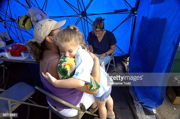 Samana Henley goes through triage at North Carolina Med 1 with her mother Regina Henley and her brother Austin Henley on September 18 2005 in...