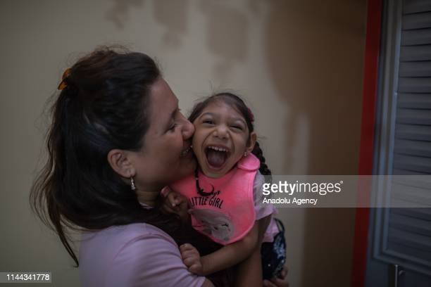 Samantha, 3 years old, and her mother, Jéssica, play at home in Neiva, Huila, Colombia on May 13, 2019. A generation of children with microcephaly...