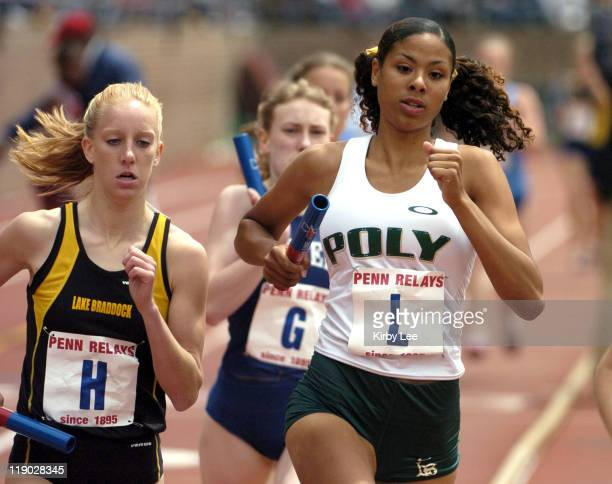 Samantha Allen leads of Long Beach Poly leads Kelsey Snowden of Lake Braddock in the Championship of America girls 4 x 800meter relay in the 111th...