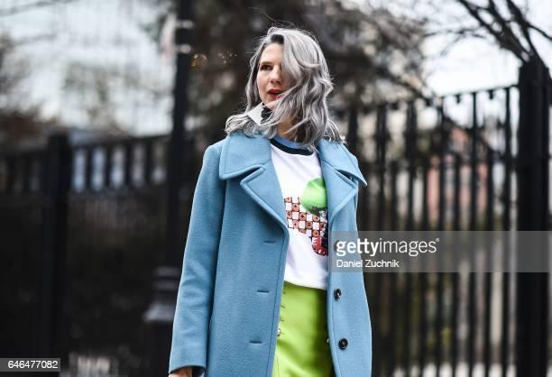 Samantha Angelo is seen in Tribeca wearing a Prada tshirt Gucci skirt Chloe coat and Missoni earrings on February 28 2017 in New York City