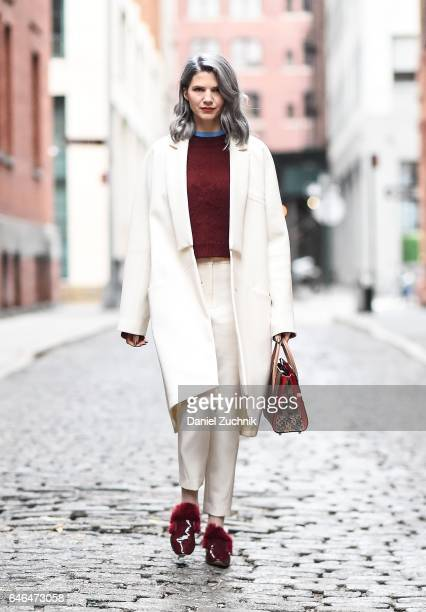 Samantha Angelo is seen in Tribeca wearing an ICB NY white coat and pants Cinq a Sept sweater Josefinas shoes and a Christian Louboutin bag on...