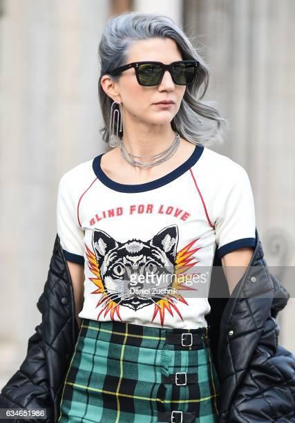 Samantha Angelo is seen wearing a Gucci top, Gucci plaid skirt, Stella McCartney coat, Dita Eyewear sunglasses, Gucci bag and Jennifer Fisher...