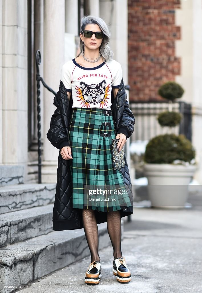 Samantha Angelo is seen wearing a Gucci top, Guccie plaid skirt, Stella McCartney coat, Missoni shoes, Dita Eyewear sunglasses, Gucci bag and Jennifer Fisher earrings outside of the Milly show during New York Fashion Week: Women's Fall/Winter 2017 on February 10, 2017 in New York City.