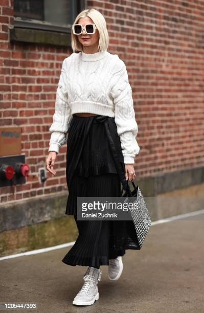 Samantha Angelo is seen wearing a white sweater and black sheer skirt with white sunglasses outside the Zimmermann show during New York Fashion Week:...