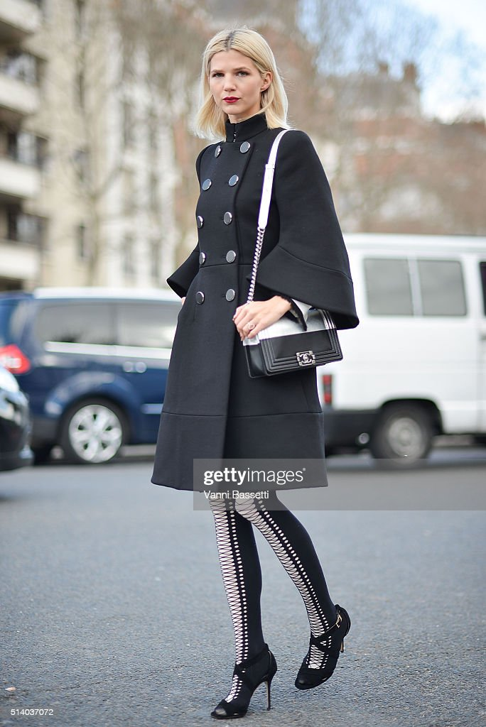 Samantha Angelo poses wearing an Alexander McQueen coat, Chanel bag and Jimmy Choo shoes after the Celine show at the Tennis Club de Paris show during Paris Fashion Week FW 16/17 on March 6, 2016 in Paris, France.