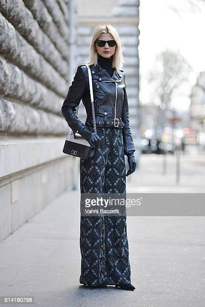 Samantha Angelo poses wearing Dior pants and Chanel bag after the Hermes show during Paris Fashion Week FW 16/17 on March 7 2016 in Paris France