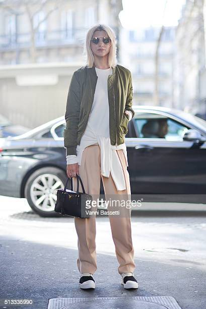 Samantha Angelo poses wearing Topshop bomber jacket Chloe pants and Prada bag after the Wanda Nylon show during Paris Fashion Week FW16/17 on March 2...