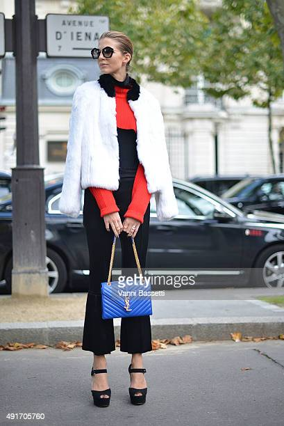 Samantha Angelo poses with an Yves Saint Laurent bag before the Miu Miu show at the Palais de Iena during Paris Fashion Week SS16 on October 7 2015...