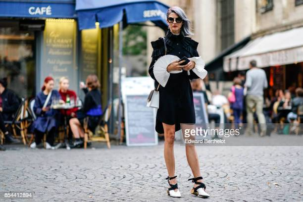 Samantha Angelo wears a black skirt with ruffles white shoes outside Koche during Paris Fashion Week Womenswear Spring/Summer 2018 on September 26...