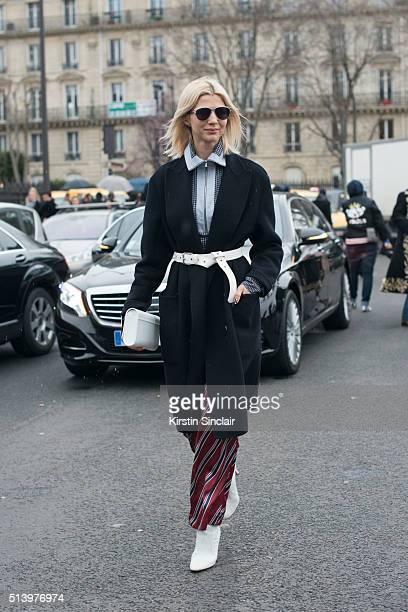 Samantha Angelo wears a Bottega Veneta Moco Pijama trousers Acne belt Chloe bag Tamara shoes and Dior glasses on day 2 during Paris Fashion Week...