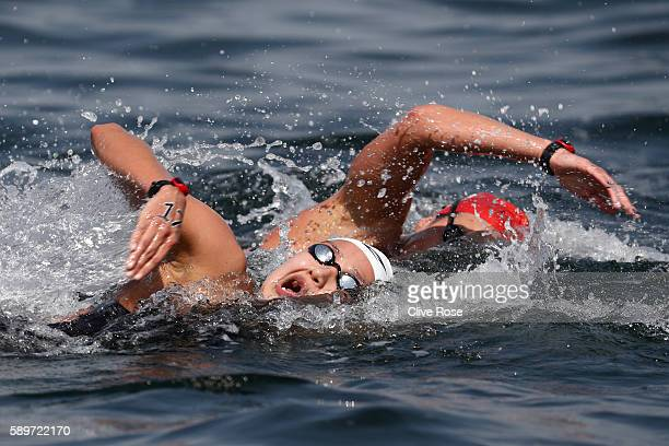 Samantha Arevalo Salinas of Ecuador and KeriAnne Payne of Great Britain competes in the Women's 10km Marathon Swimming on day 10 of the Rio 2016...