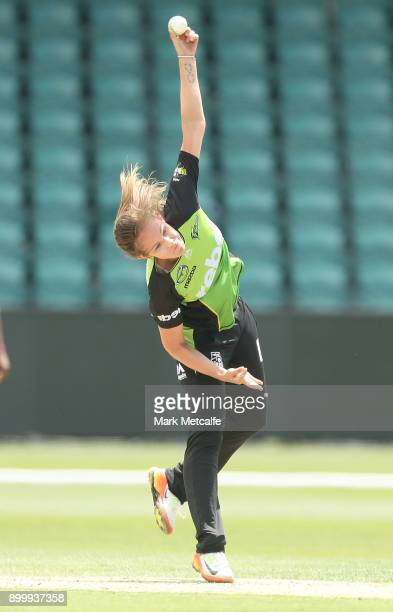 Samantha Bates of the Thunder bowls during the Women's Big Bash League match between the Sydney Thunder and the Hobart Hurricanes at the University...