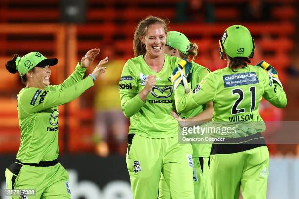 Samantha Bates of the Thunder celebrates dismissing Grace Harris of the Heat during the Women's Big Bash League WBBL Semi Final match between the...