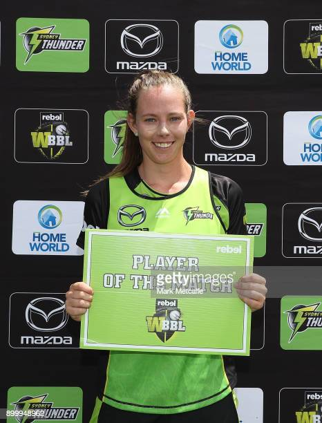 Samantha Bates of the Thunder poses with the player of the match award during the Women's Big Bash League match between the Sydney Thunder and the...
