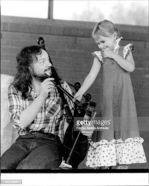 Samantha Bennett 4 finds Folk Music Musician Alan Stivell Galic Speech a little Strange as he shows her Bagpipes he uses in his concert April 16 1977