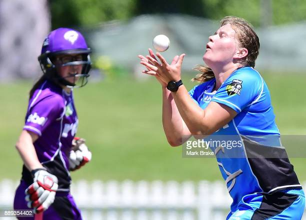 Samantha Betts of the Adelaide Strikers cayches Katelyn Fryett of the Hobart Hurricanes during the Women's Big Bash League WBBL match between the...