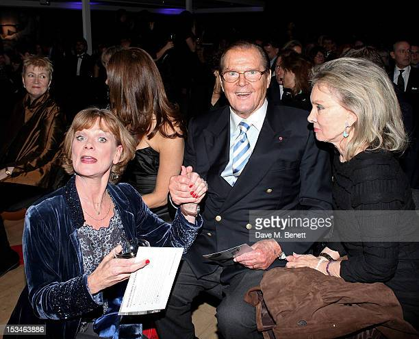 Samantha Bond Sir Roger Moore and wife Christina Tholstrup attend '50 Years Of James Bond The Auction' celebrating the 50th anniversary of the film...