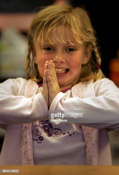 –Samantha Brittingham warms up with some exercises before her handwriting lesson in Becke Prince's second grade classroom at Don Juan Avila...