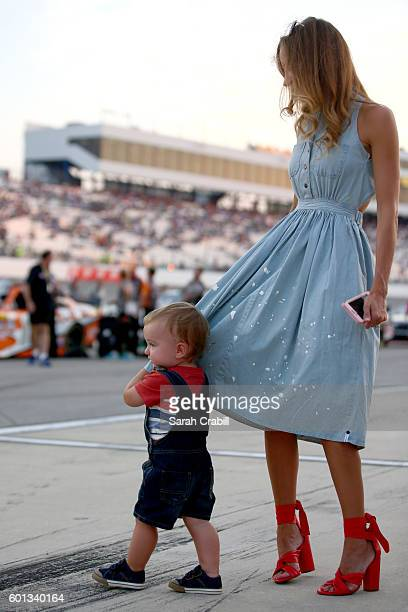 Samantha Busch and her son Brexton stand on pit road prior to the NASCAR XFINITY Series Virginia529 College Savings 250 at Richmond International...