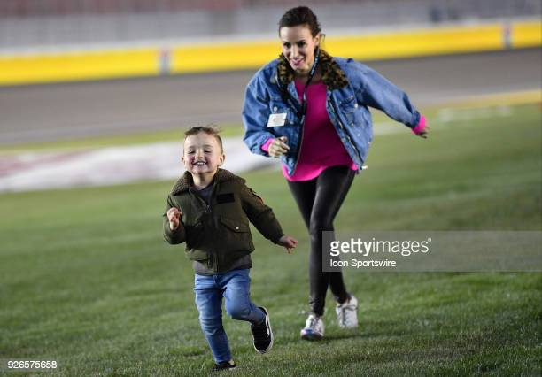 Samantha Busch wife of NASCAR Camping World Truck Series driver Kyle Busch plays with her son Brexton before the Stratosphere 200 at Las Vegas Motor...