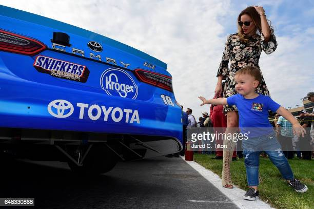 Samantha Busch wife of NASCAR driver Kyle Busch stands on the grid with their son Brexton prior to the Monster Energy NASCAR Cup Series Folds Of...