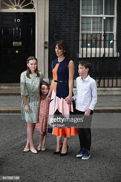 Samantha Cameron and children Nancy Cameron Arthur Cameron and Florence Cameron look on as Prime Minister David Cameron speaks as he leaves Downing...