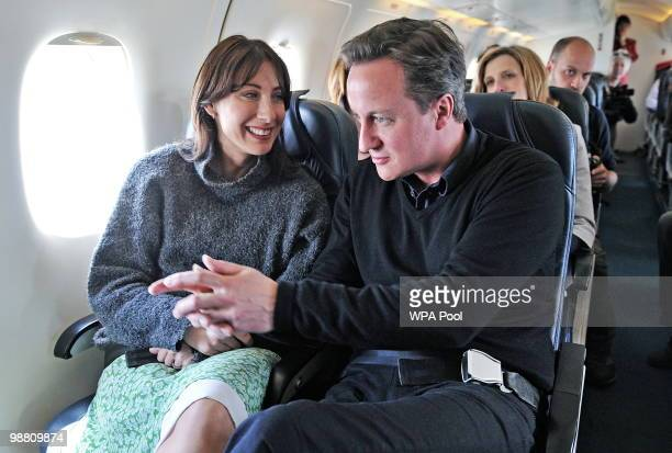 Samantha Cameron and Conservative Party Leader David Cameron are pictured on a private plane as they fly from Blackpool to London on May 3, 2010 on...