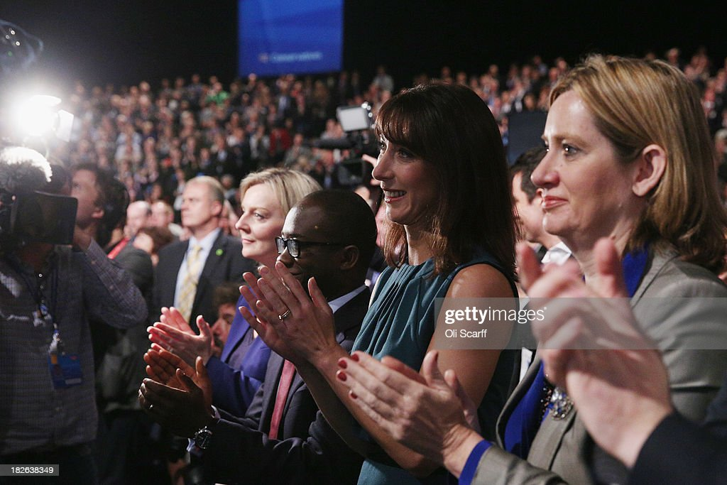 Samantha Cameron (C) applauds her husband, the British Prime Minister David Cameron, after he delivered his keynote speech on the last day of the annual Conservative Party Conference at Manchester Central on October 2, 2013 in Manchester, England. During his closing speech David Cameron will say that his 'abiding mission' would make the UK into a 'land of opportunity'.