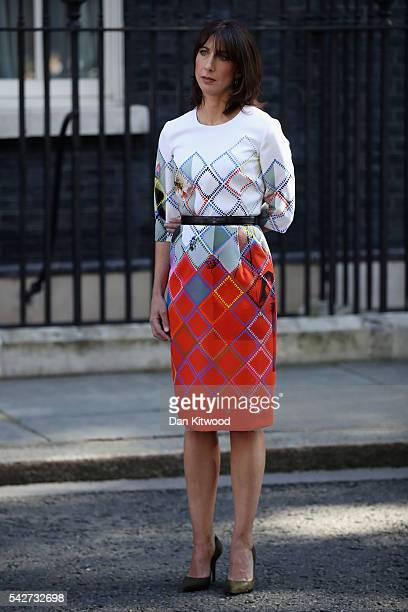 Samantha Cameron listens as her husband British Prime Minister David Cameron resigns on the steps of 10 Downing Street on June 24 2016 in London...