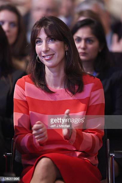 Samantha Cameron listens to her husband British Prime Minister David Cameron deliver his keynote speech to delegates at the annual Conservative Party...