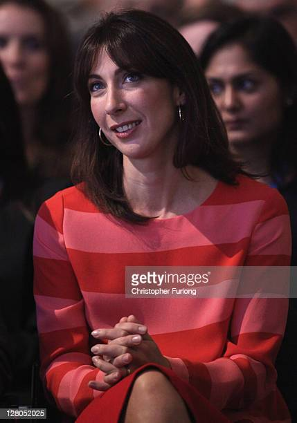 Samantha Cameron listens to her husband, British Prime Minister David Cameron, deliver his keynote speech to delegates at the annual Conservative...