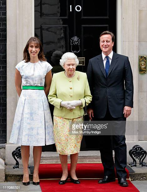 Samantha Cameron, Queen Elizabeth II and Prime Minister David Cameron stand on the doorstep of number 10 Downing Street as The Queen and Prince...