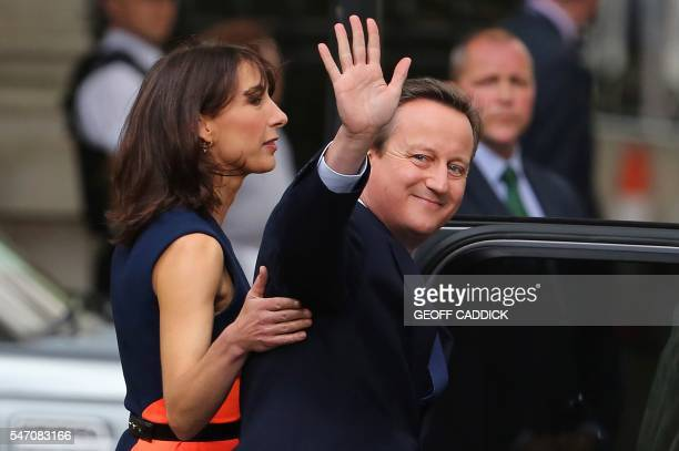 TOPSHOT Samantha Cameron stands with her husband outgoing British prime minister David Cameron as he waves after speaking outside 10 Downing Street...