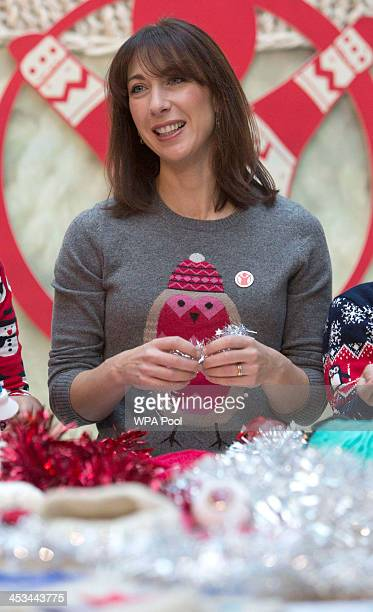 Samantha Cameron the wife of Britain's Prime Minister David Cameron attends a jumper decoration workshop on December 4 2013 in East London England
