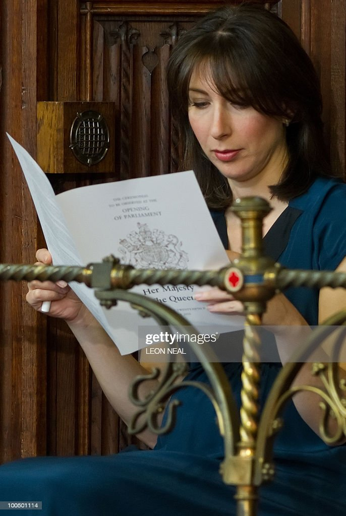 Samantha Cameron, wife of Britain's Conservative Prime Minister, David Cameron, reads the order of service before Queen Elizabeth II addressed the House of Lords for the State Opening of Parliament, at the Houses of Parliament, in Westminster, central London on May 25, 2010. Britain's Queen Elizabeth II set out the new coalition government's legislative programme on Tuesday in a ceremony of pomp and history following the closest general election for decades. AFP PHOTO/Leon Neal/Pool