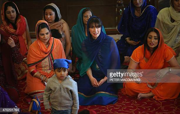 Samantha Cameron wife of Britain's Prime Minister and leader of the Conservative Party David Cameron sits with Conservative parliamentary candidate...