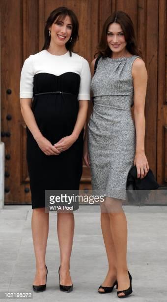 Samantha Cameron wife of British Prime Minister David Cameron greets Carla BruniSarkozy wife of President Nicolas Sarkozy at the Royal Chelsea...