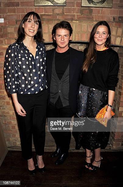 Samantha Cameron Wife of British Prime Minister David Cameron designer Christopher Kane and business partner Tammy Kane attend the British Fashion...