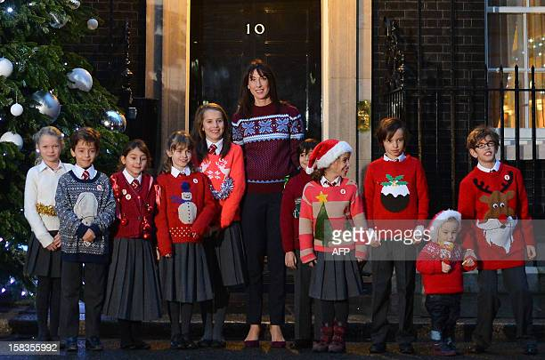 Samantha Cameron wife of British Prime Minister David Cameron poses with children for Save the Children's Christmas Jumper Day in front of number 10...