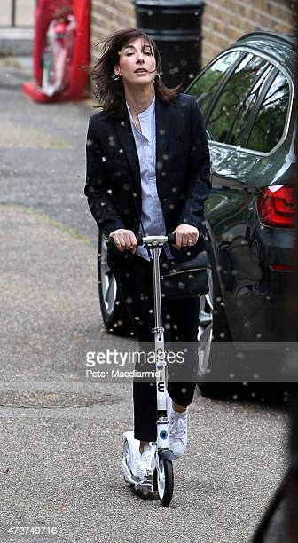 Samantha Cameron wife of Prime Minister David Cameron rides a scooter at the back entrance to number 10 Downing Street as pollen falls on May 9 2015...