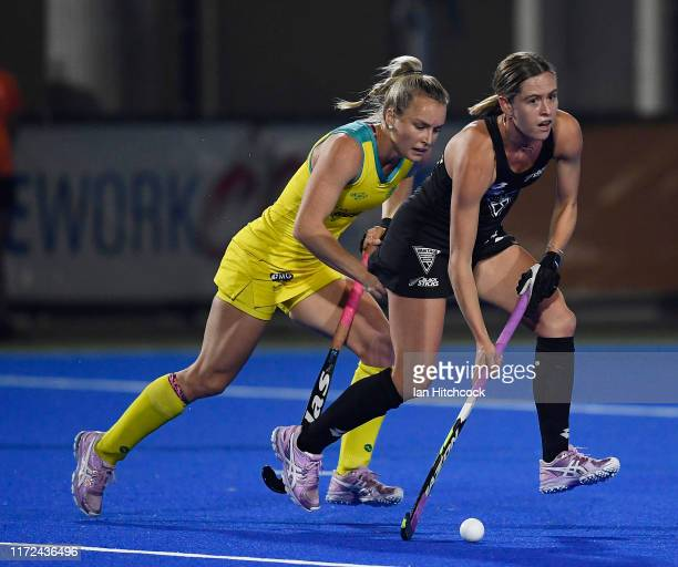 Samantha Charlton of New Zealand gets away from Jane Claxton of Australia during the 2019 Oceania Cup match between the Australian Hockeyroos and the...