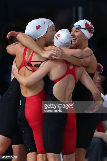 Samantha Cheverton Brittany Maclean Alyson Ackman and Emily Overholt of Canada celebrate winning the silver medal in the Women's 4 x 200m Freestyle...