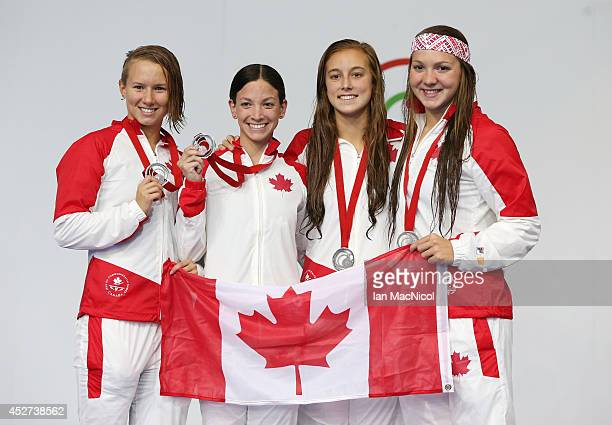 Samantha Cheverton Brittany McLean Alyson Ackman and Emily Overholt of Canada pose after winning silver in the Women's 4x200m Freestyle Final at...