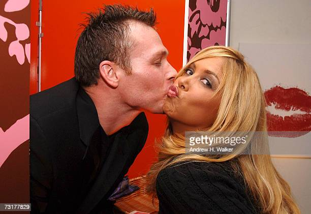 Samantha Cole enjoys the kissing booth at the Macy's 'Kiss Tell' hosted by Nicky Hilton on February 1 2007 in New York City