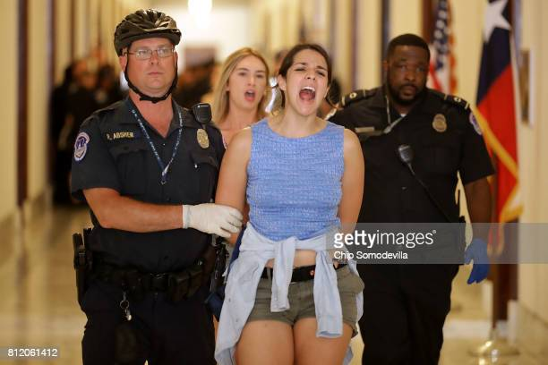 Samantha Coronado of Tucson, AZ, and fellow demonstrators are arrested after protesting outside the offices of Sen. Jeff Flake against health care...