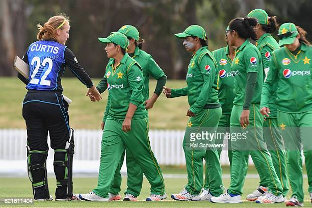 Samantha Curtis of New Zealand is congratulated by the Pakistan players following the Women's One Day International match between the New Zealand...