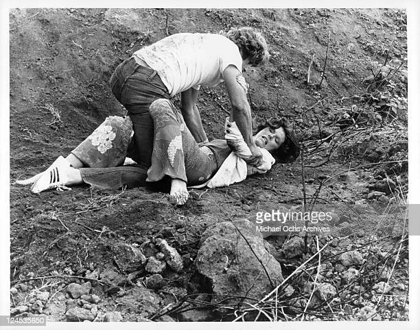 Samantha Eggar grapples with Alex Cord near a recently excavated 3000 year old Etruscan tomb in a scene from the film 'The Dead Are Alive' 1972
