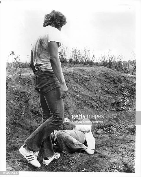 Samantha Eggar lies cowering at the feet of Alex Cord near a recently excavated 3000 year old Etruscan tomb in a scene from the film 'The Dead Are...